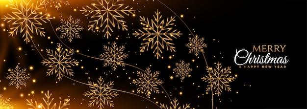 Banner de feliz natal flocos de neve preto e dourado Vetor grátis