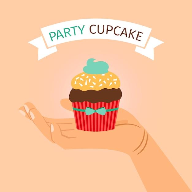 Banner de festa com a mão segurando o cupcake Vetor Premium