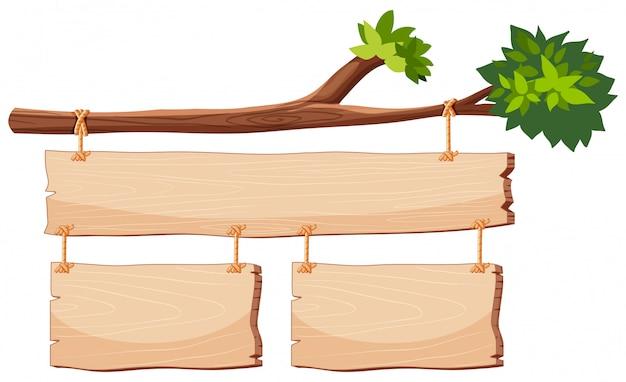 Banner de madeira no ramo de árvore Vetor grátis
