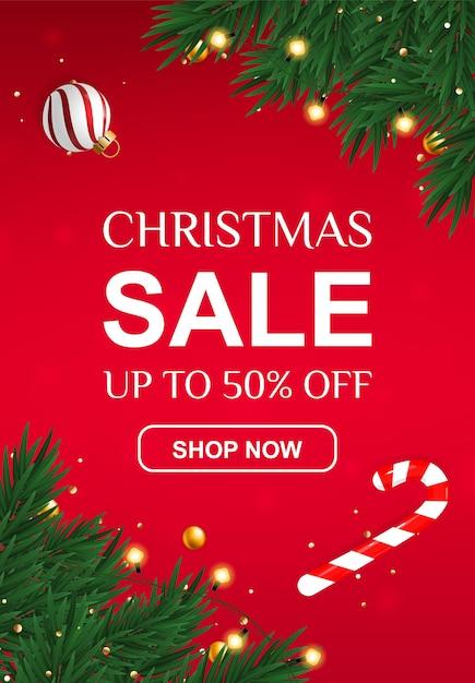 Banner de venda de natal com 50% de desconto com bengala e ramos de abeto. Vetor Premium