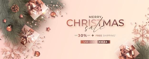 Banner de venda de natal com decoração realista em rosa dourada Vetor grátis