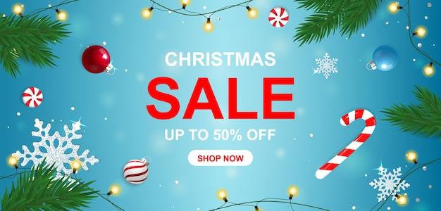 Banner de venda de natal com doces e flocos de neve. Vetor Premium