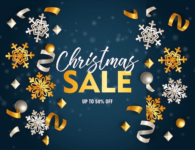 Banner de venda de natal com fitas e flocos no chão azul Vetor grátis