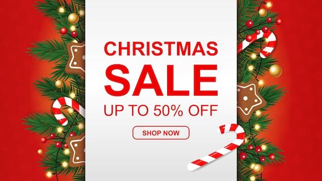 Banner de venda de natal com pão de mel, bastão de doces em fundo vermelho. Vetor Premium