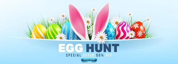 Banner de venda de páscoa com ovos de páscoa e flor Vetor Premium
