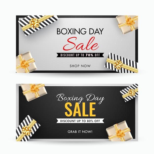 Banner de venda dia de boxe com desconto diferente e vista superior das caixas de presente decoradas em cinza e preto Vetor Premium