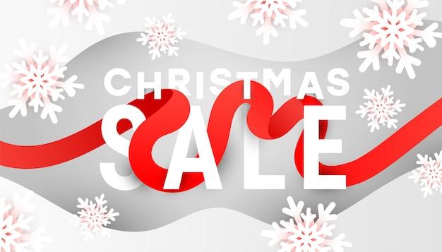Banner de venda feliz natal com flocos de neve brancos e ondas de líquidos líquidos em fundo cinza Vetor Premium