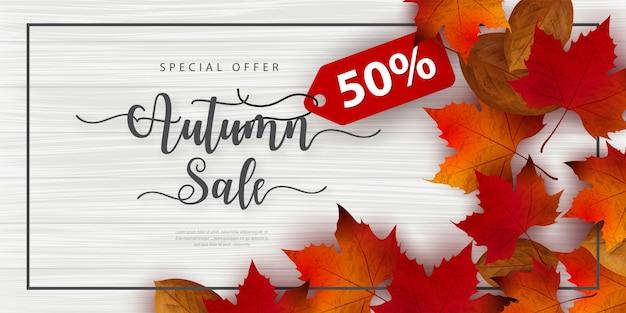 Banner de venda outono decorar com folhas Vetor Premium