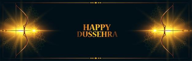 Banner do festival indiano feliz dussehra com vetor de arco e flecha brilhante Vetor grátis