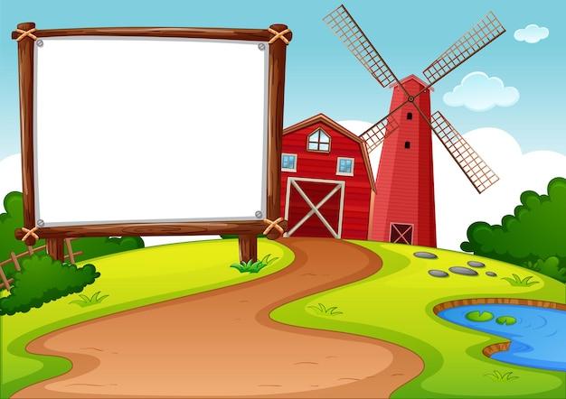 Banner em branco em fazenda com celeiro vermelho e cena do moinho de vento Vetor grátis