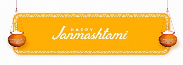Banner feliz do festival janmashtami com mão pendurada Vetor grátis