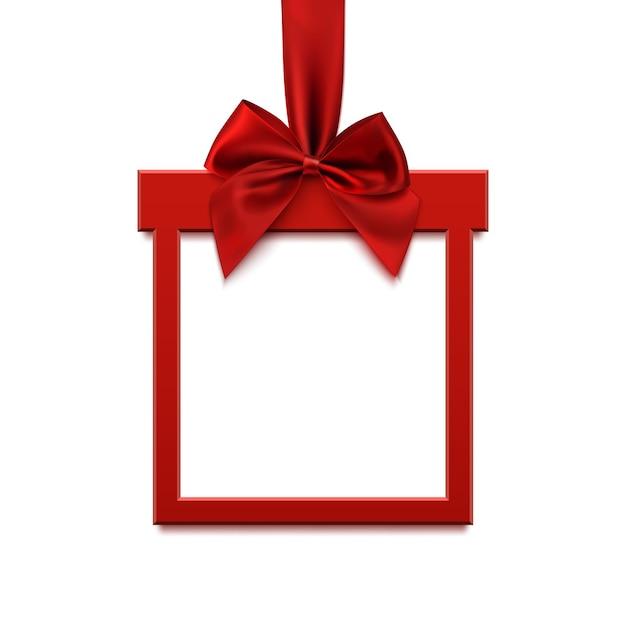 Banner quadrado em branco em forma de presente de natal com fita vermelha e arco, isolado no fundo branco. modelo de cartão, folheto ou banner. Vetor Premium