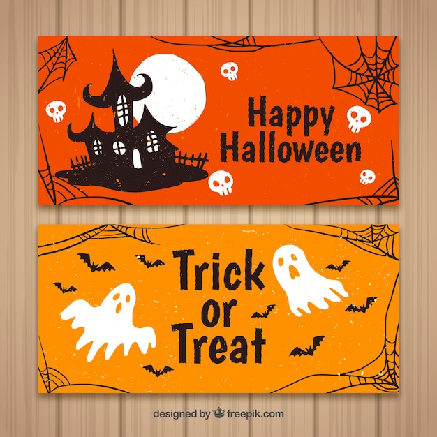 Banners de halloween com casa e fantasmas Vetor grátis