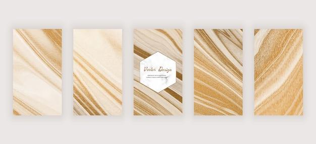Banners de histórias em mídias sociais com tinta líquida dourada e textura de mármore Vetor Premium