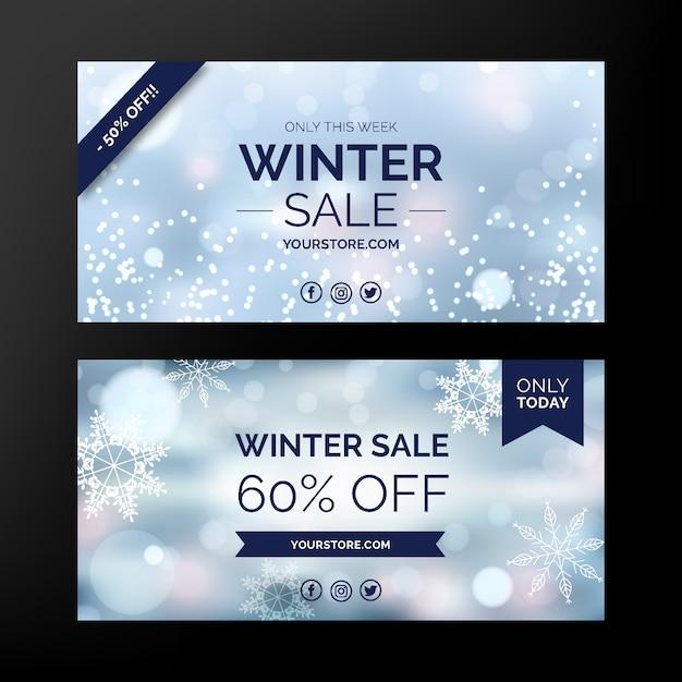 Banners de venda turva inverno com flocos de neve Vetor grátis