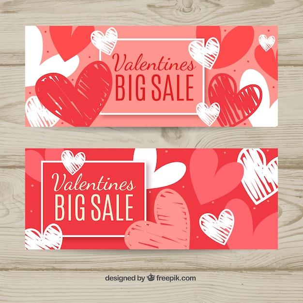 Banners desenhados à mão no dia dos namorados Vetor grátis
