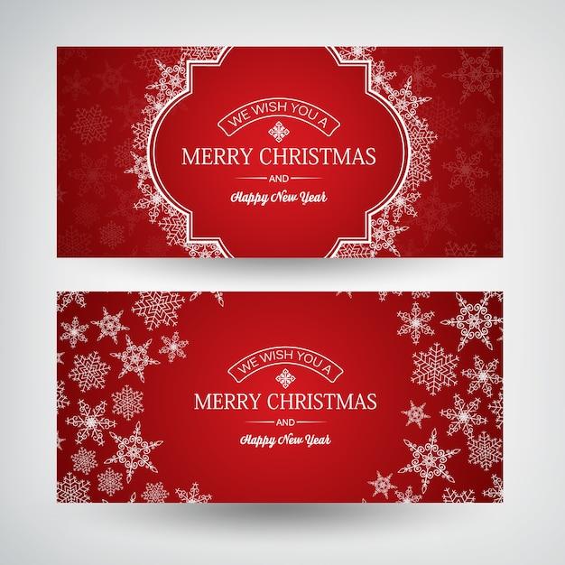 Banners horizontais de natal e feliz ano novo com inscrições de saudação e lindos flocos de neve em vermelho Vetor grátis