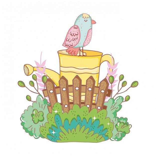 Belo pássaro com aspersão e jardim de vedação Vetor Premium
