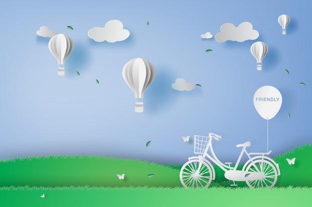 Bicicleta no parque do jardim com balões de ar. Vetor Premium