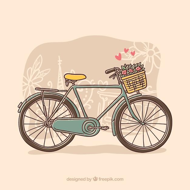 Bicicleta tirada à mão com flores e corações Vetor grátis