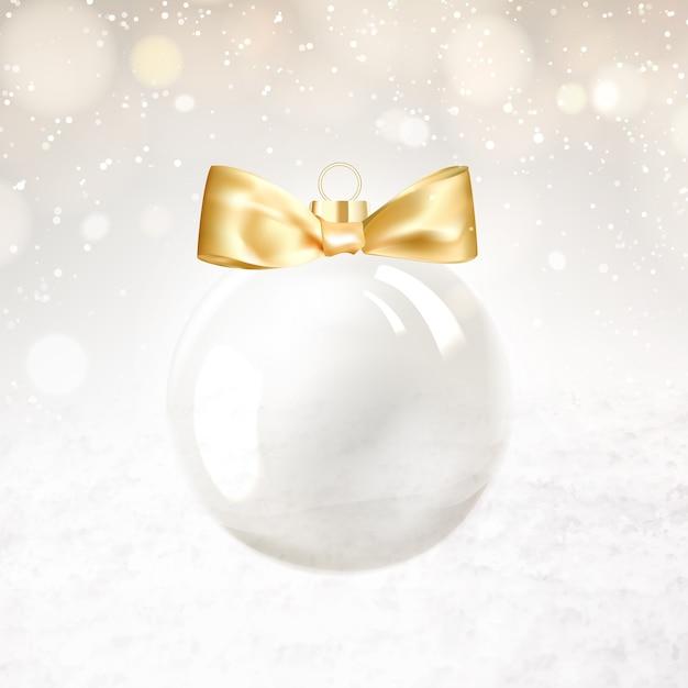 Bola dourada de natal com faíscas desfocadas Vetor grátis