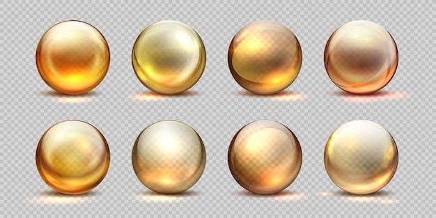 Bolas de colágeno de ouro. óleo cosmético realista, gota de soro líquido, comprimidos 3d isolados transparentes. conjunto de gotas de colágeno amarelo Vetor Premium