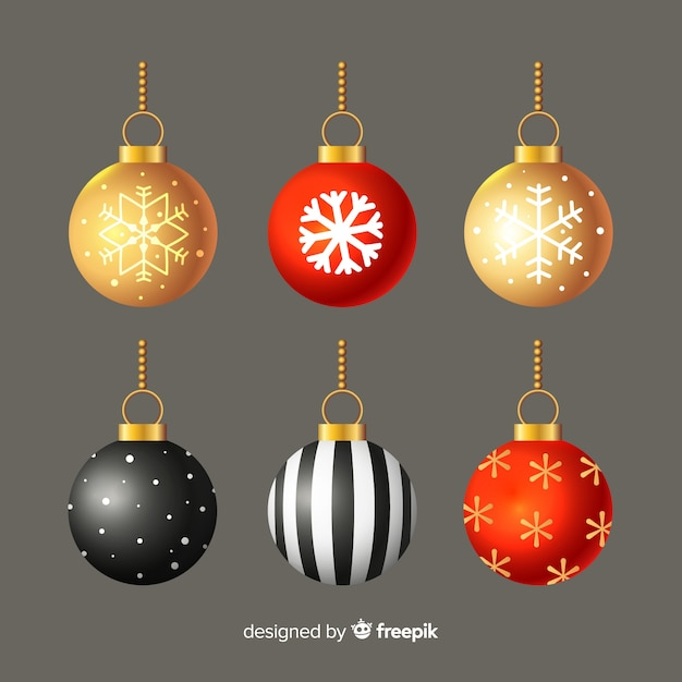 Bolas de natal de design plano em fundo cinza Vetor grátis