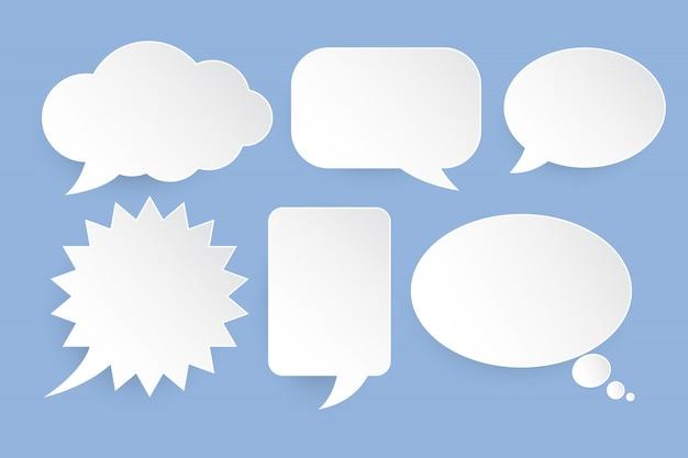 Bolhas do discurso branco em fundo azul Vetor Premium