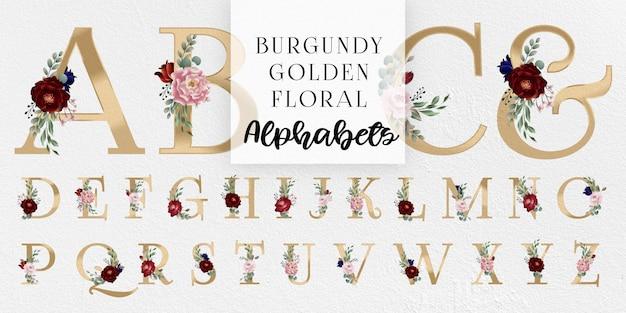 Borgonha e blush floral alfabetos dourados Vetor Premium