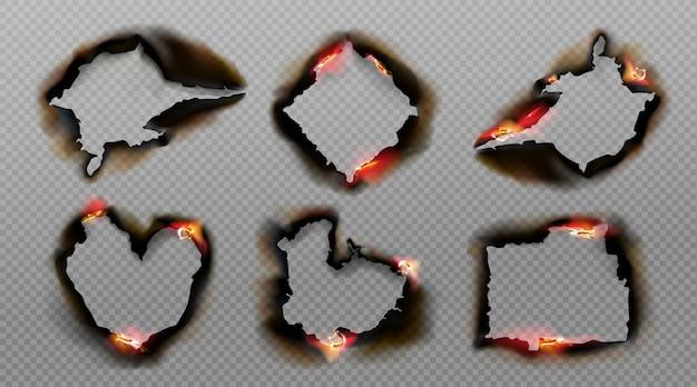 Buracos queimados em papel com fogo e cinza negra Vetor grátis