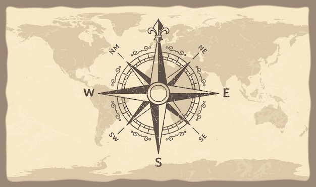 Bússola antiga no mapa do mundo Vetor Premium