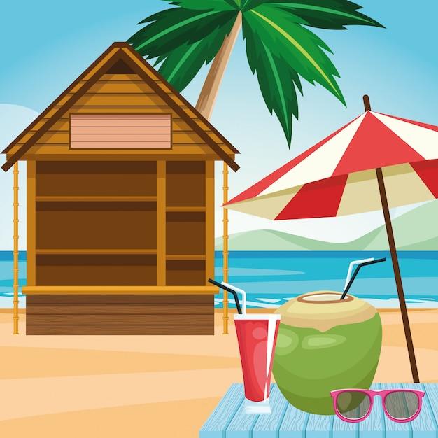Cabana e guarda-sol com bebida de coco e óculos de sol na praia Vetor Premium