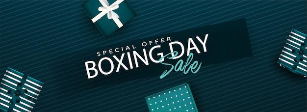 Cabeçalho do site ou banner com texto de venda de dia de boxe e vista superior das caixas de presente decoradas em verde listrado Vetor Premium
