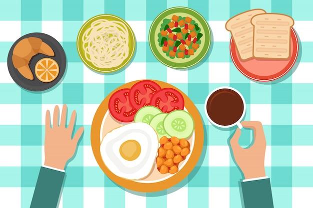 Café da manhã que come o alimento em placas e na mão do homem na tabela. Vetor Premium