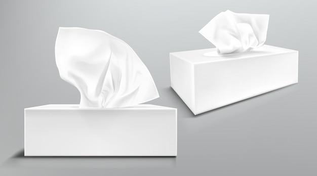 Caixa com guardanapos de papel branco dianteiros e vista de ângulo. maquete realista de vetor de pacote de papelão em branco com lenços faciais ou lenços isolados Vetor grátis