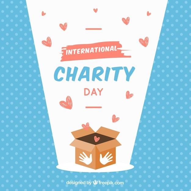 Caixa, corações e dia internacional da caridade Vetor grátis
