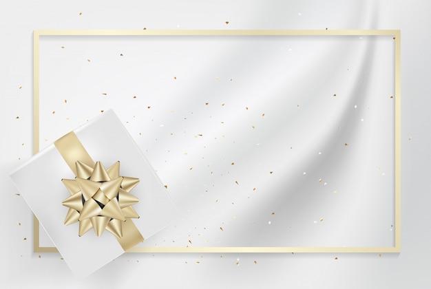 Caixa de presente branca e fitas de laço de ouro com textura de seda luz confete. Vetor Premium
