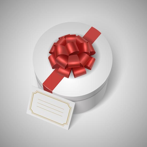 Caixa de presente clássica com fita vermelha, arco e lable branco Vetor grátis