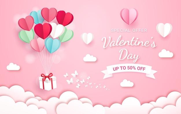 Caixa de presente com balão no estilo de corte de papel do céu. fundo do cartão de dia dos namorados. Vetor Premium