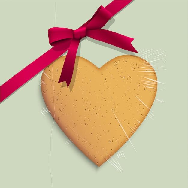 Caixa de presente com biscoito de coração em forma de fita rosa amarrada Vetor Premium