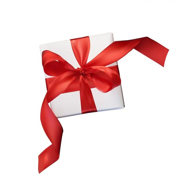 Caixa de presente com um laço vermelho em transparente isolado no branco Vetor Premium