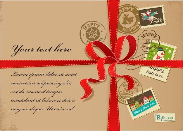 Caixa de presente de natal com selos coloridos e fitas vermelhas Vetor Premium