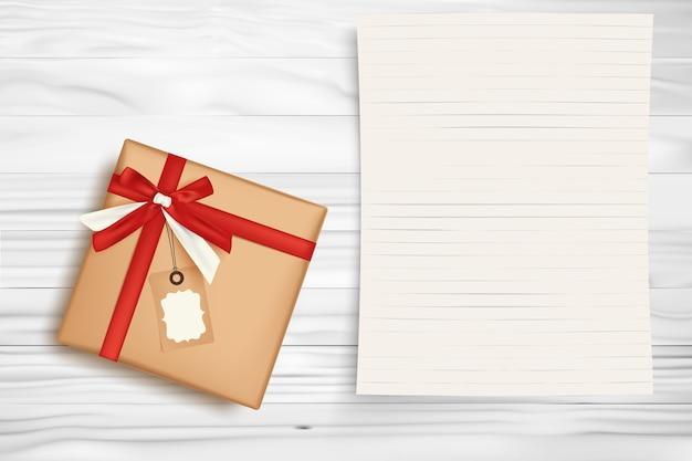 Caixa de presente de natal e papel de nota em branco Vetor Premium
