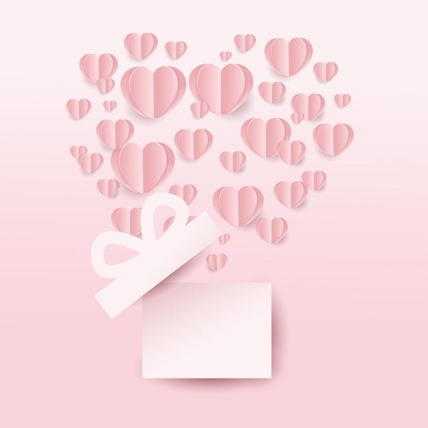 Caixa de presente de valentineâ € ™ s e corações que voam, forma do coração no fundo cor-de-rosa. estilo de corte de papel. ilustração vetorial Vetor Premium