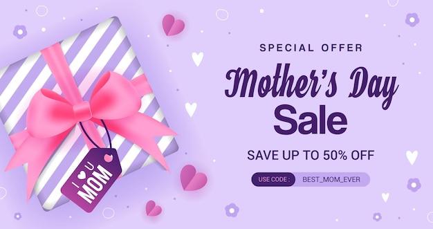 Caixa de presente de venda do dia das mães em fundo roxo Vetor Premium