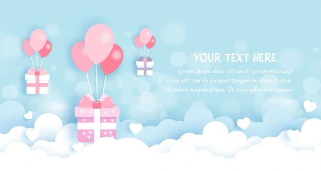 Caixas de presente com balões no céu em papel cortado Vetor Premium
