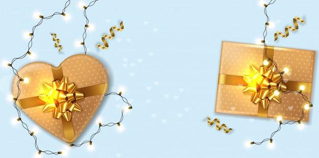 Caixas de presente de ouro com guirlanda de luzes Vetor Premium