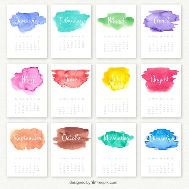 Calendário anual com manchas de aquarela Vetor Premium