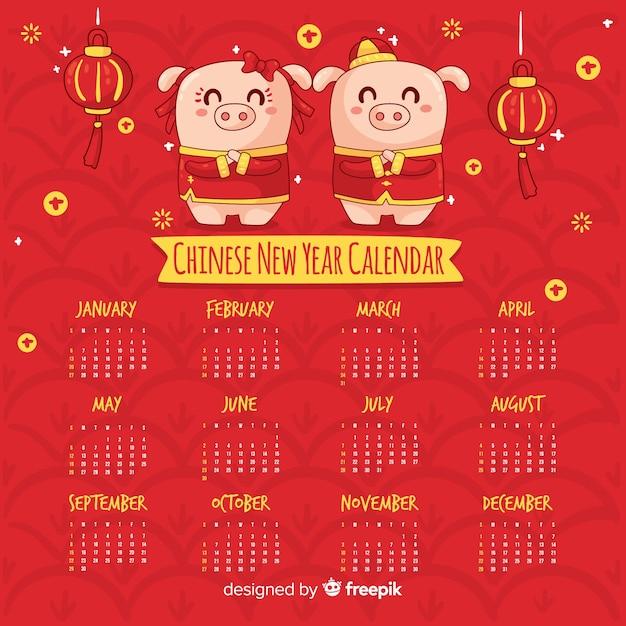 Calendário de ano novo chinês porcos dos desenhos animados Vetor grátis