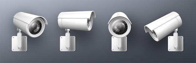 Câmera de segurança, câmera de vídeo cctv, equipamento de vigilância de rua, visão frontal e lateral em ângulo. vigilância segura e prevenção de crime isolada em fundo cinza conjunto de ilustração 3d realista Vetor grátis